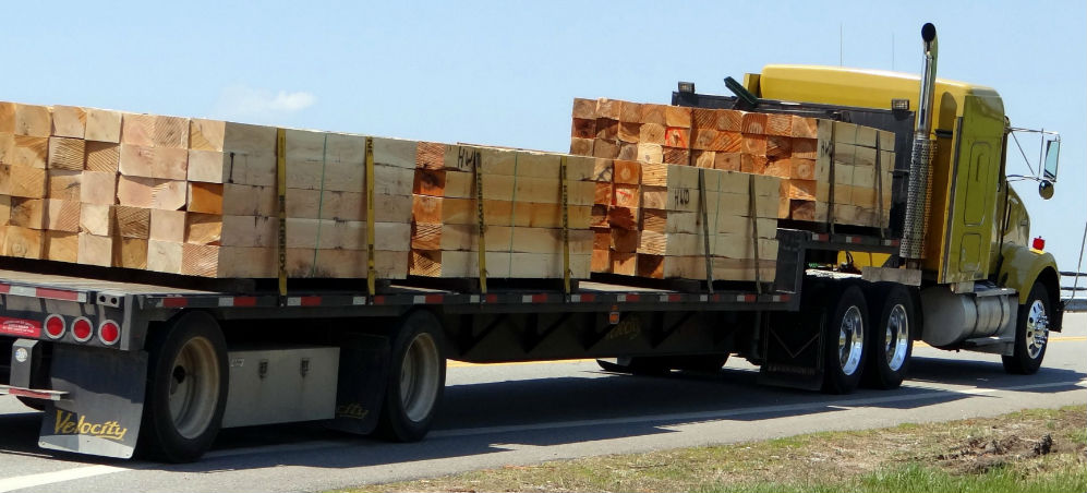 Yellow Truck Carrying Wood