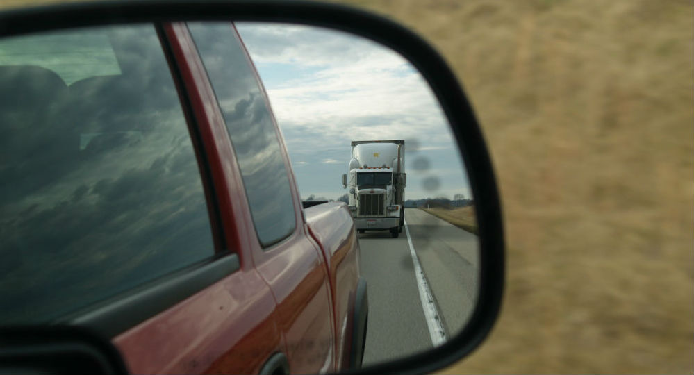 White Truck In The Rearview Mirror, Truck Accident Lawyer