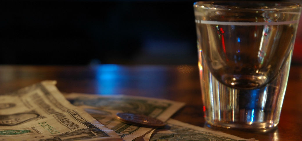 an alcoholic beverage and money